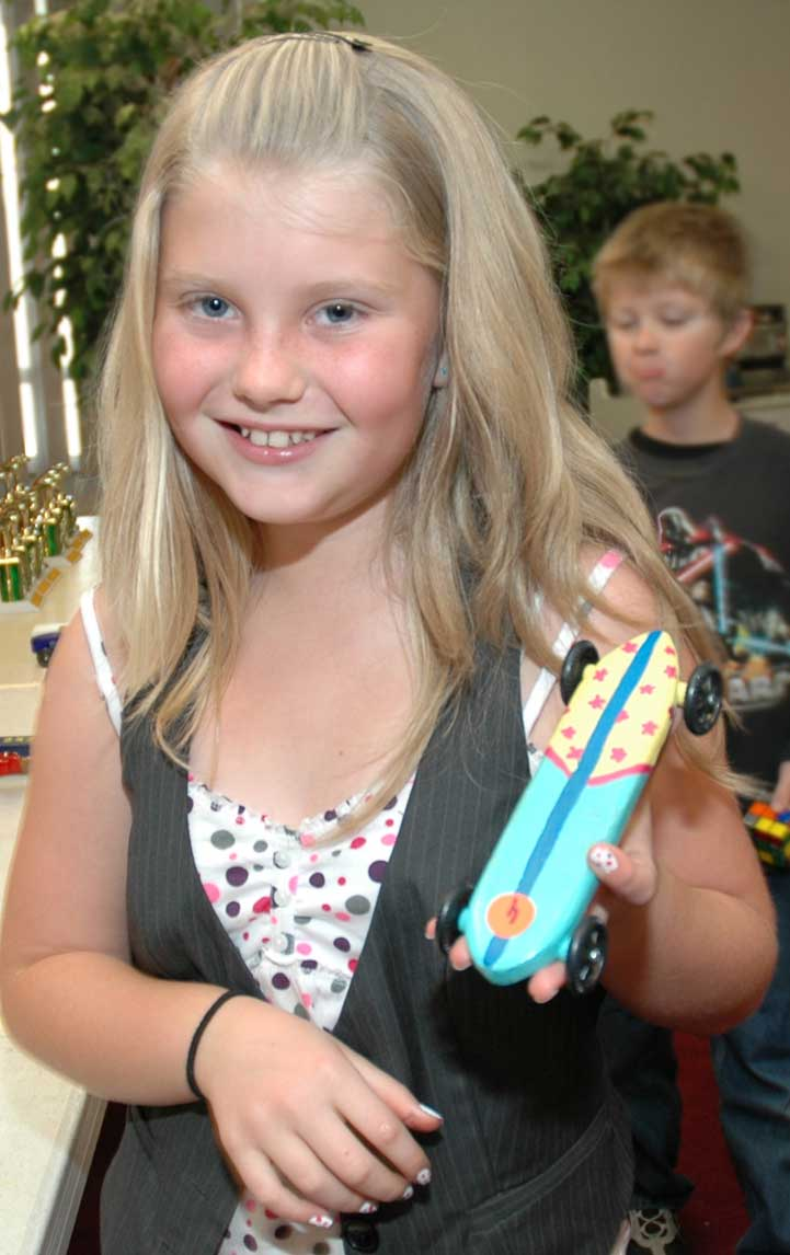 My daughter loves to surf, so she made a pinewood derby surboard.