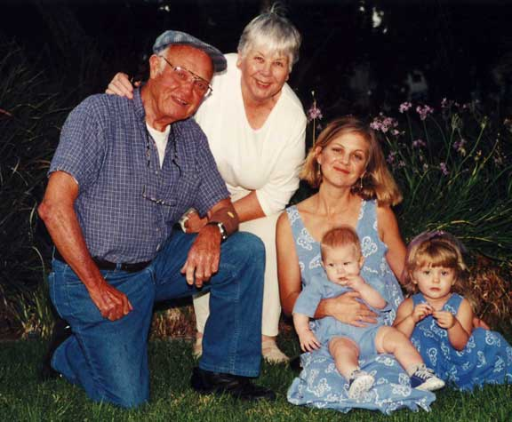My dad, mom and me with my two kids around 2000.
