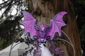 The wedding trellis is topped by a gorgeous bat.